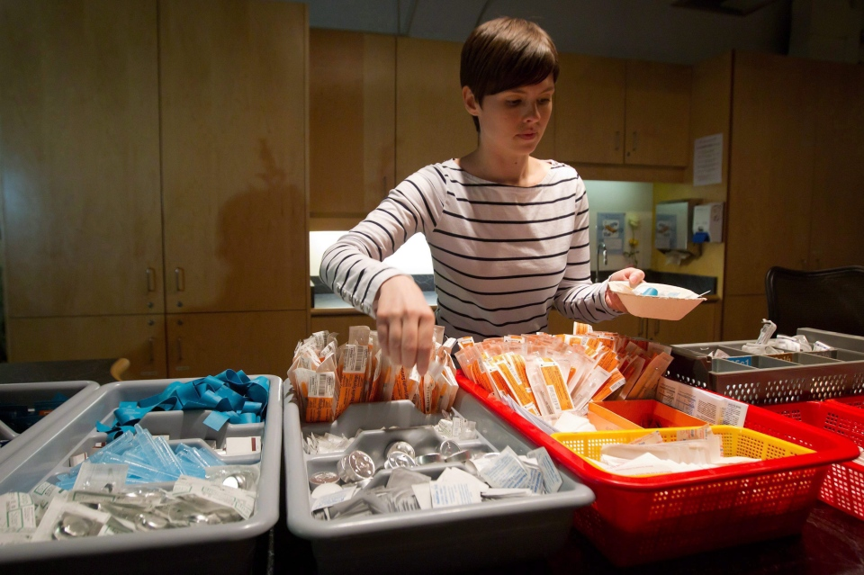 In this May 11, 2011 file photo, registered nurse Sammy Mullally prepares a tray of supplies at the Insite safe injection clinic in Vancouver, B.C. (Darryl Dyck / THE CANADIAN PRESS)