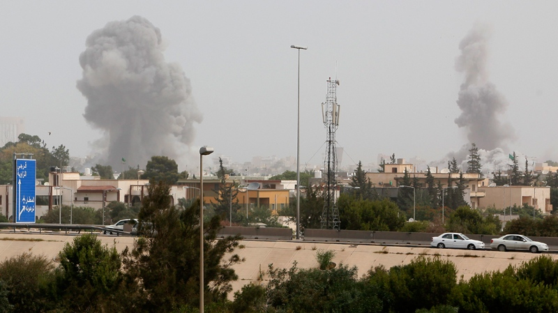 A smoke and dust cloud from an explosions rises into the sky after a NATO airstrike in Tripoli, Libya Tuesday, June 7, 2011. (AP / Abdel Meguid al-Fergany)