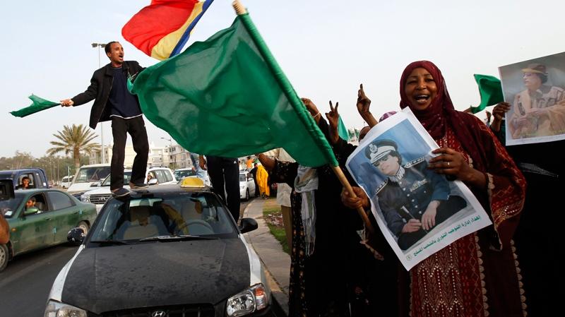 Libyans rally next to Moammar Gadhafi's Bab al-Aziziya compound, a regular target of NATO airstrikes, in Tripoli, Libya, on Tuesday, June 7, 2011. (AP / Ivan Sekretarev)
