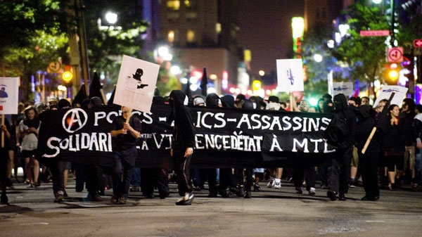 Protestors march in Montreal, Wednesday, June 8, 2011. The march was prompted by tragic events Tuesday: police shot and killed two people - a homeless man allegedly wielding a knife, and an innocent bystander who was on his way to work at a hospital. THE CANADIAN PRESS/Graham Hughes