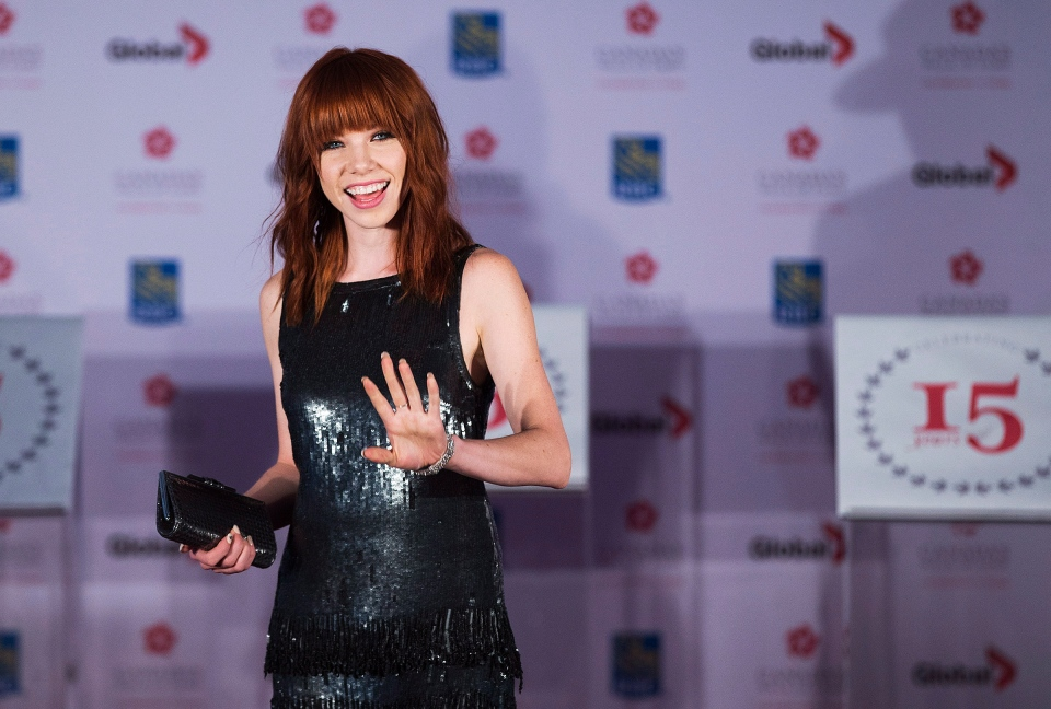 Carly Rae Jepsen, who received the 2013 Allan Slaight Award, poses for a photo as her award is announced at the Canada's Walk of Fame induction ceremony in Toronto on Saturday, September 21, 2013. ( Michelle Siu / THE CANADIAN PRESS)