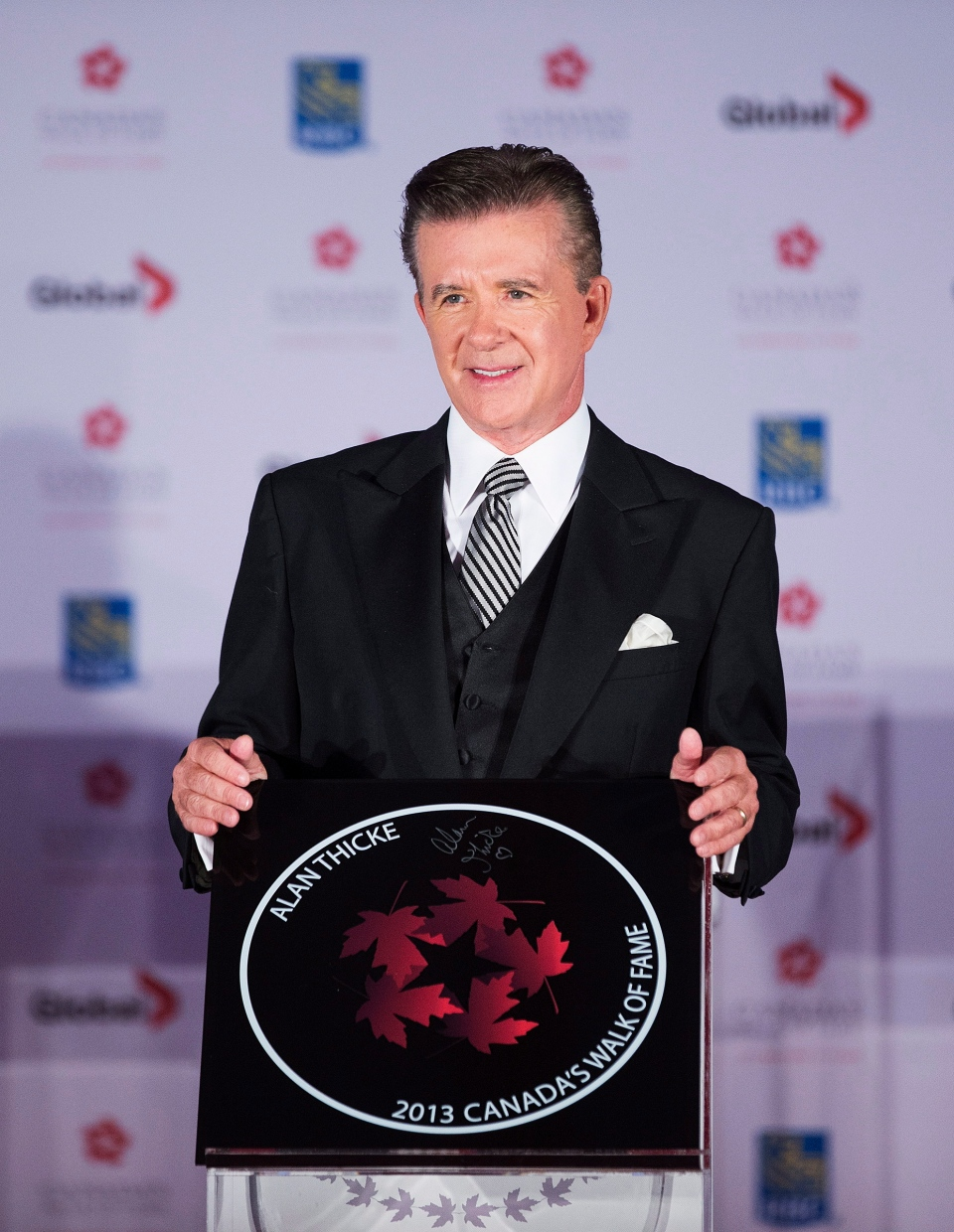 Actor Alan Thicke poses for a photo during his induction ceremony into Canada's Walk of Fame in Toronto on Saturday, September 21, 2013. (Michelle Siu / THE CANADIAN PRESS)