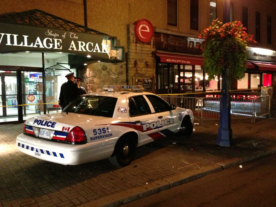 A police cruiser is shown outside a Yorkville bar, where five people were injured in a shooting early Sunday morning. (Tom Podolec)