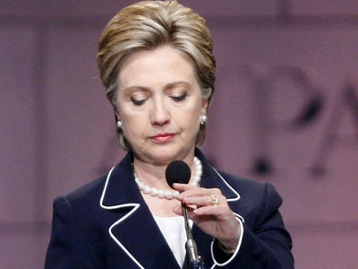 Democratic presidential hopeful Sen. Hillary Rodham Clinton, D-N.Y., adjusts her microphone during a speech in Washington on Wednesday, June 4, 2008. (AP / Charles Dharapak)