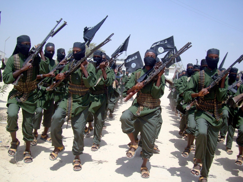 Al-Shabab fighters march with their weapons during military exercises on the outskirts of Mogadishu, Somalia, Thursday, Feb. 17, 2011. (AP / Mohamed Sheikh Nor)