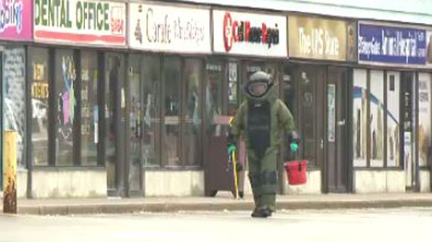 Police respond to a bank robbery at the TD Canada Trust branch on Hespeler Road. The thieves said they had an explosive device. -- July 4, 2013