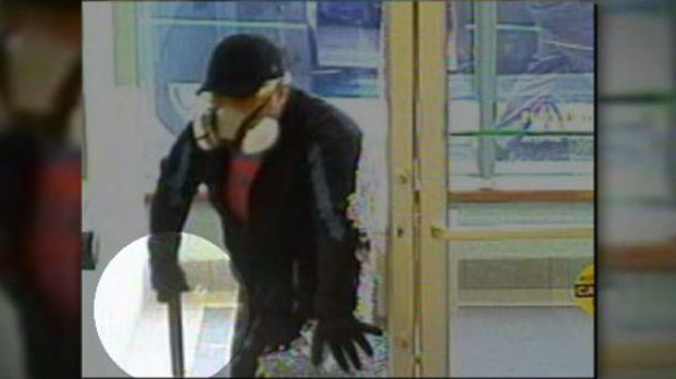 Suspect in TD Canada Trust bank robbery seen in security footage. -- July 4, 2013