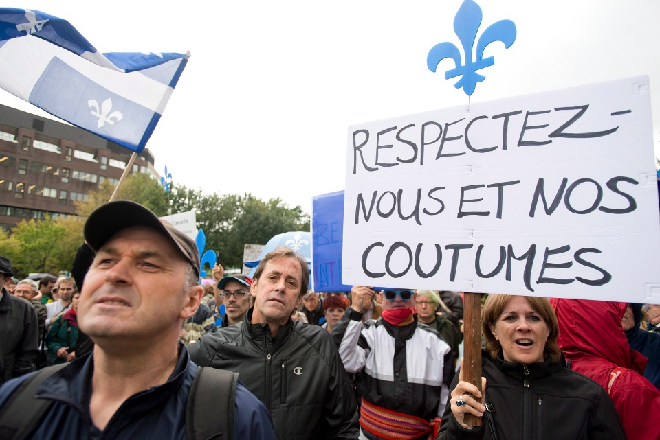 Supporters of a proposed Quebec values charter gather in Montreal on Sunday, Sept. 22, 2013. (Graham Hughes / THE CANADIAN PRESS)