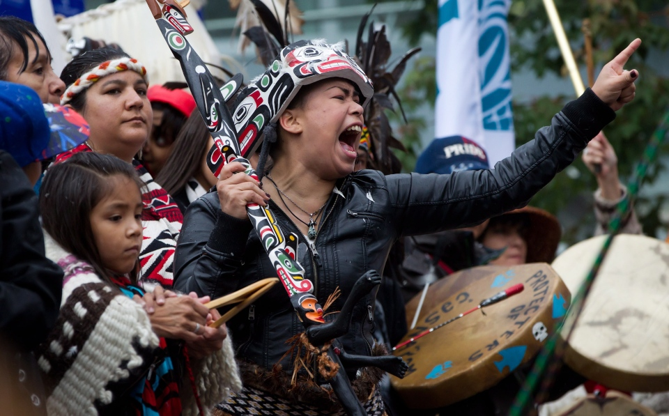 A First Nations woman cheers while taking part in the Walk for Reconciliation in Vancouver, B.C., on Sunday September 22, 2013. (Darryl Dyck / THE CANADIAN PRESS)