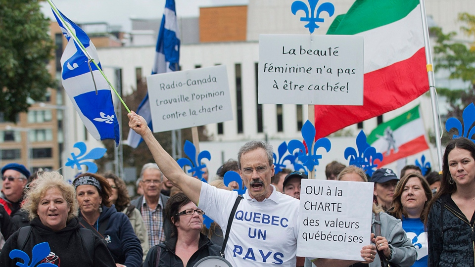 Supporters of a proposed Quebec values charter march in Montreal, Sunday, Sept. 22, 2013. (Graham Hughes / THE CANADIAN PRESS)
