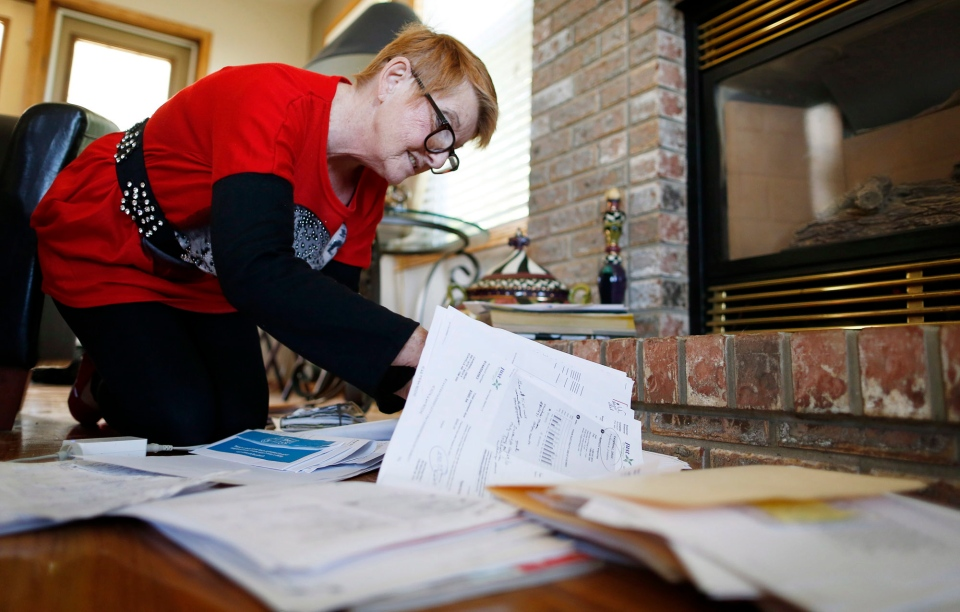 The Alberta pensioner says she feels like a prisoner after her rental property was claimed as an 'embassy' by a man she says identified himself as a Freemen-on-the-Land, a growing movement of so-called sovereign citizens that is raising concerns with authorities both north and south of the border. (Jeff McIntosh / THE CANADIAN PRESS)