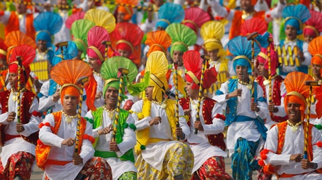 Indian school children perform a Punjabi folk dance Bhangra at the Republic Day parade in New Delhi, India, Wednesday, Jan. 26, 2011. The day marks the anniversary of India's adoption of a democratic constitution.(AP Photo/Gurinder Osan)