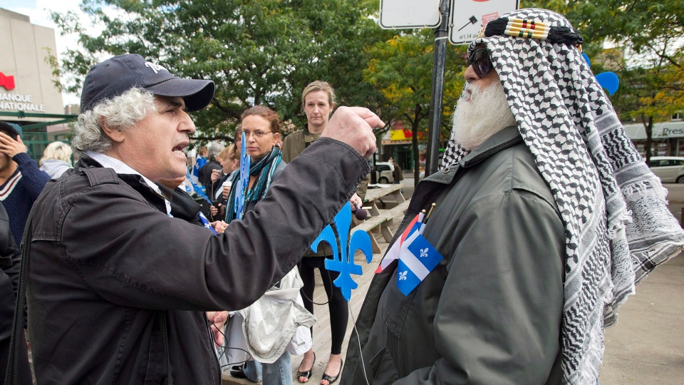 Two men argue during a demonstration in support of a proposed Quebec values charter in Montreal, Sunday, Sept. 22, 2013. (Graham Hughes / THE CANADIAN PRESS)
