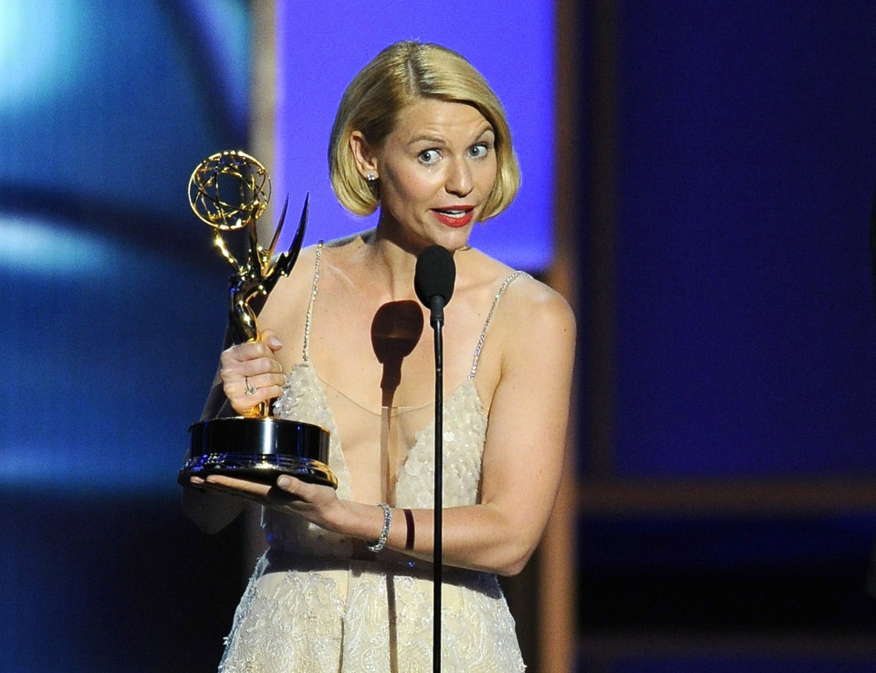 Claire Danes accepts the award for outstanding lead actress in a drama series for her role on 'Homeland' as presenter Jimmy Fallon looks on at right at the 65th Primetime Emmy Awards at Nokia Theatre on Sunday Sept. 22, 2013, in Los Angeles. (Chris Pizzello / Invision)