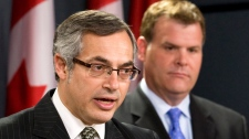 Minister of Foreign Affairs John Baird and President of the Treasury Board and Minister for the Federal Economic Development Initiative for Northern Ontario Tony Clement comment on the Auditor Generals report in Ottawa, Thursday, June 9, 2011. (Adrian Wyld / THE CANADIAN PRESS)