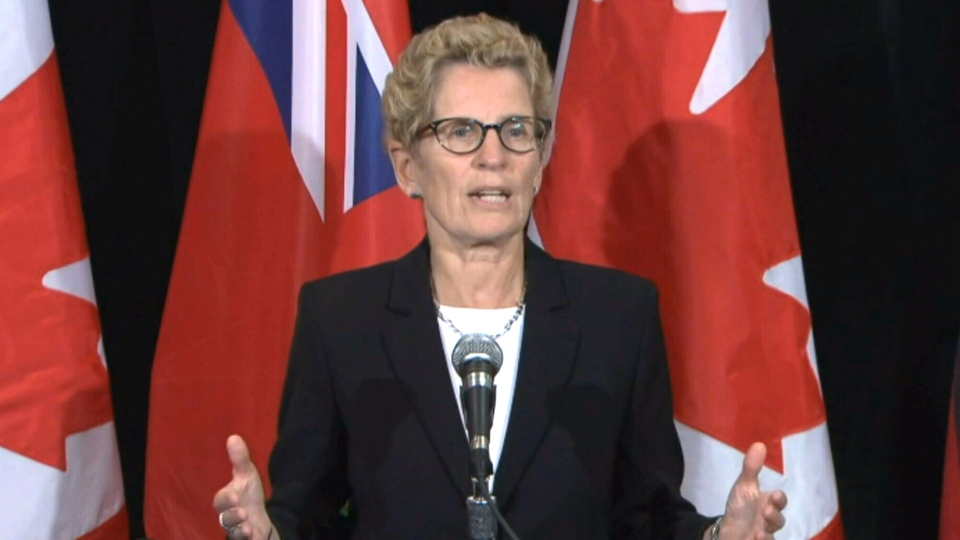 Premier Kathleen Wynne speaks to reporters in Toronto, Monday, Sept. 23, 2013.