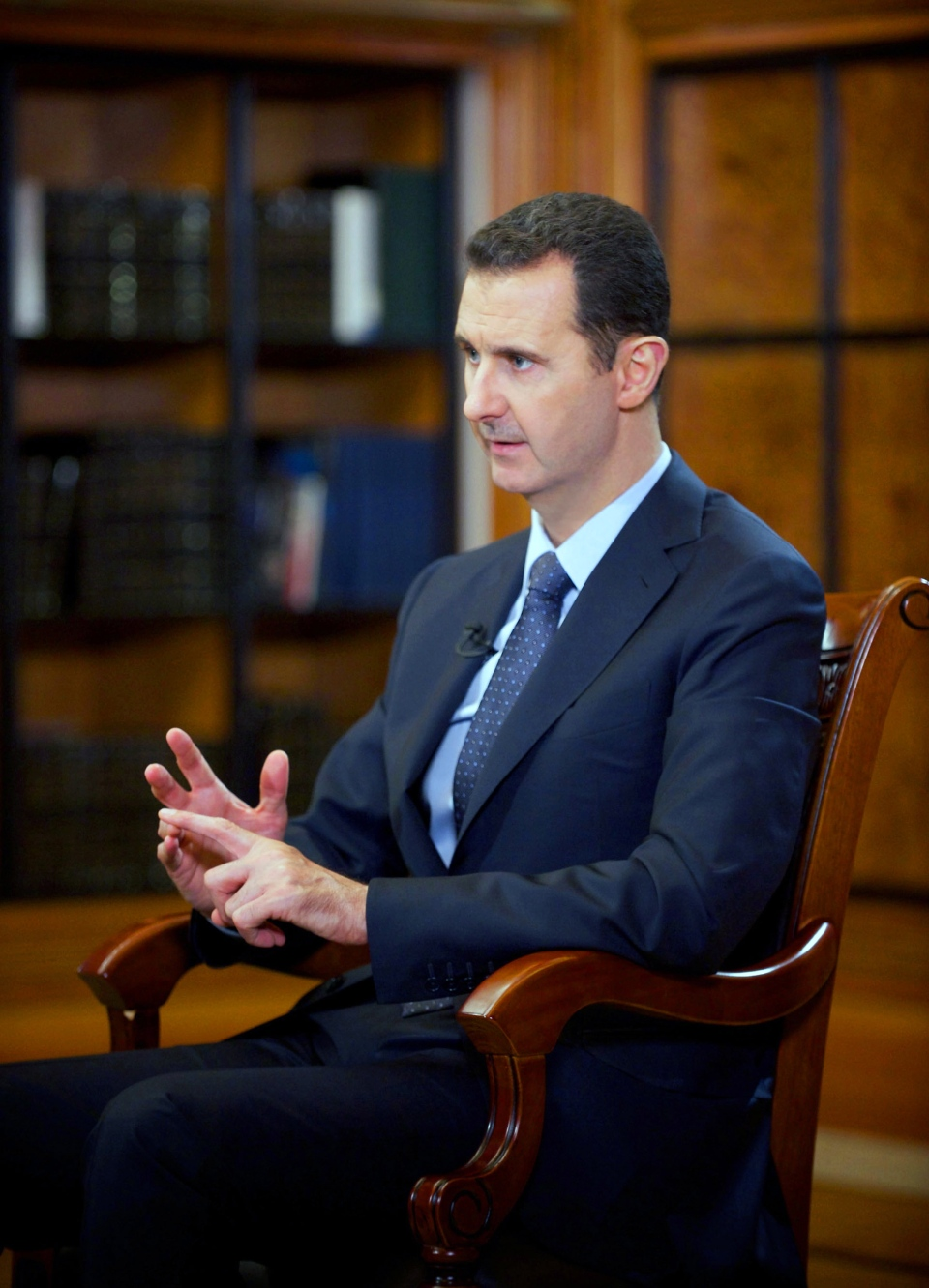 In this photo released by the Syrian official news agency SANA, Syrian President Bashar Assad speaks during an interview with Chinese state CCTV, in Damascus, Syria, Monday, Sept. 23, 2013 (SANA)