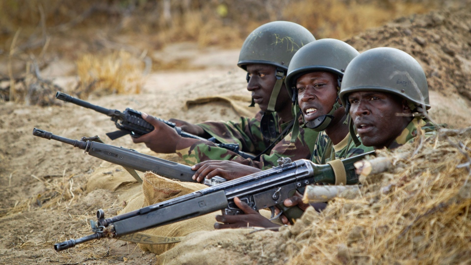 Kenyan army soldiers stand in a dugout position during a peacekeeping mission at their base in Tabda, inside Somalia, Monday, Feb. 20, 2012. (AP / Ben Curtis)