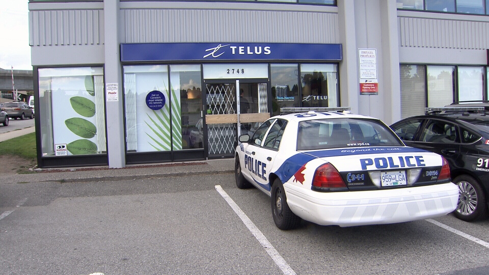 Vancouver police investigate an armed robbery at the Tom Harris Cellular Store on Rupert Street. Sept. 23, 2013. (CTV)
