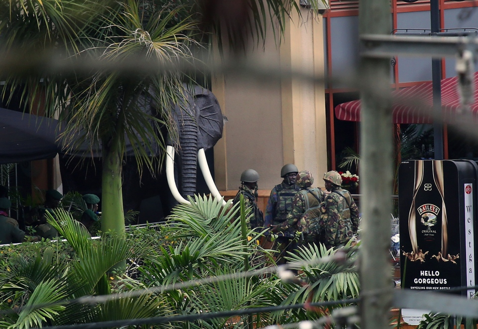 Kenyan security forces are seen at the entrance of the Westgate Mall in Nairobi, Kenya, Tuesday, Sept. 24, 2013. (AP / Jerome Delay)