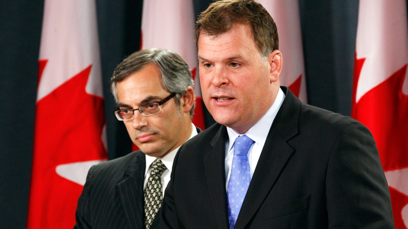 Foreign Affairs Minister John Baird, right, and Treasury Board President Tony Clement appear at a news conference in Ottawa, Thursday, June 9, 2011. (Adrian Wyld / THE CANADIAN PRESS)