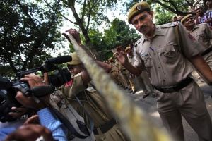 Delhi policemen put a rope to keep media personnel away as they make way for four men convicted in the fatal gang rape of a young woman on a moving New Delhi bus last year, outside the High court in New Delhi, India, Tuesday, Sept. 24, 2013. (AP Photo/Altaf Qadri)