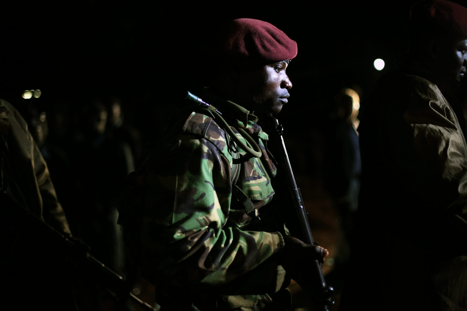 Kenyan Defense Forces leave the near vicinity of the Westgate Mall in Nairobi, Kenya, Monday, Sept. 23, 2013. (AP / Jerome Delay)