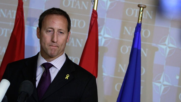 Defense minister Peter MacKay listens to questions during a media conference at a meeting of NATO defense ministers at NATO headquarters in Brussels on Thursday, June 9, 2011. (AP / Virginia Mayo)