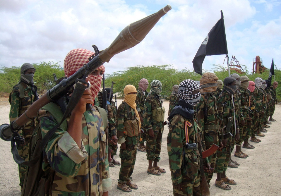 Al-Shabaab fighters display weapons as they conduct military exercises in northern Mogadishu, Somalia, Thursday Oct. 21, 2010. (AP / Farah Abdi Warsameh)