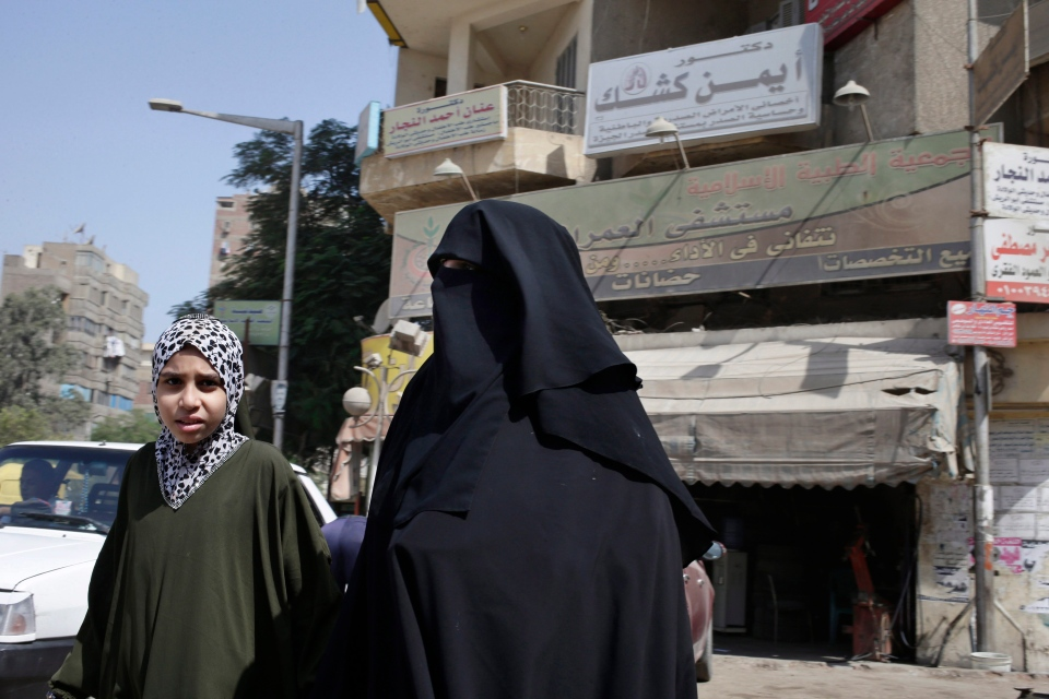 An Egyptian woman and her daughter walk in front of Al-Omraniyah hospital, run by the Muslim Brotherhood's Islamic Medical Associoation, in Cairo, Egypt in this Saturday, Sept. 21, 2013 photo. (AP / Hassan Ammar)