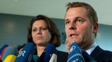 German Ariculturale and Consumer Protection Minister Ilse Aigner, left, and Health Minister Daniel Bahr, right, brief the media about new results in the search for the source of a deadly European E. coli outbreak, at the German parliament Bundestag in Berlin on Friday, June 10, 2011.  (AP / Markus Schreiber)