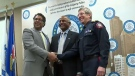 Mike Shaikh is seen here with the police chief and mayor of Calgary.