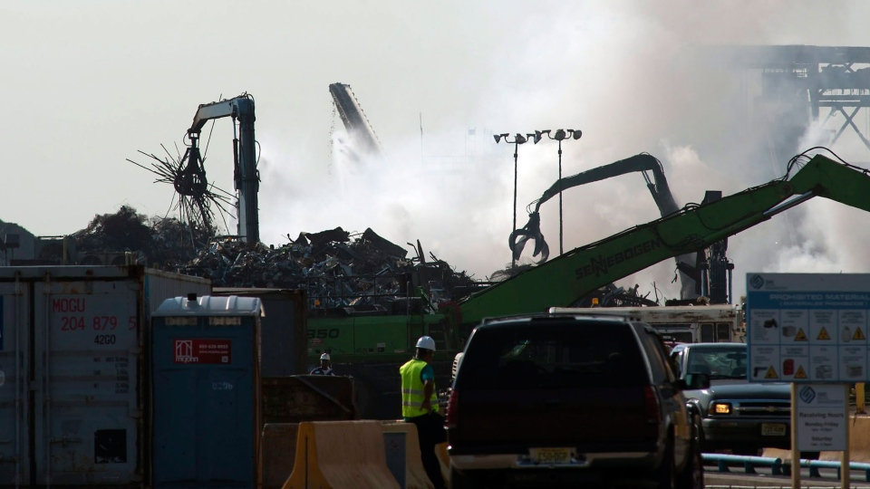 Smoke billows from a scrap metal fire at the Sims Metal Management recycling plant on Linden Avenue in Jersey City, N.J. on Tuesday, Aug. 20, 2013. (The Jersey Journal, Reena Rose Sibayan)