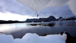 An iceberg melts in Kulusuk, Greenland near the arctic circle, Tuesday Aug, 16, 2005. (AP / John McConnico)