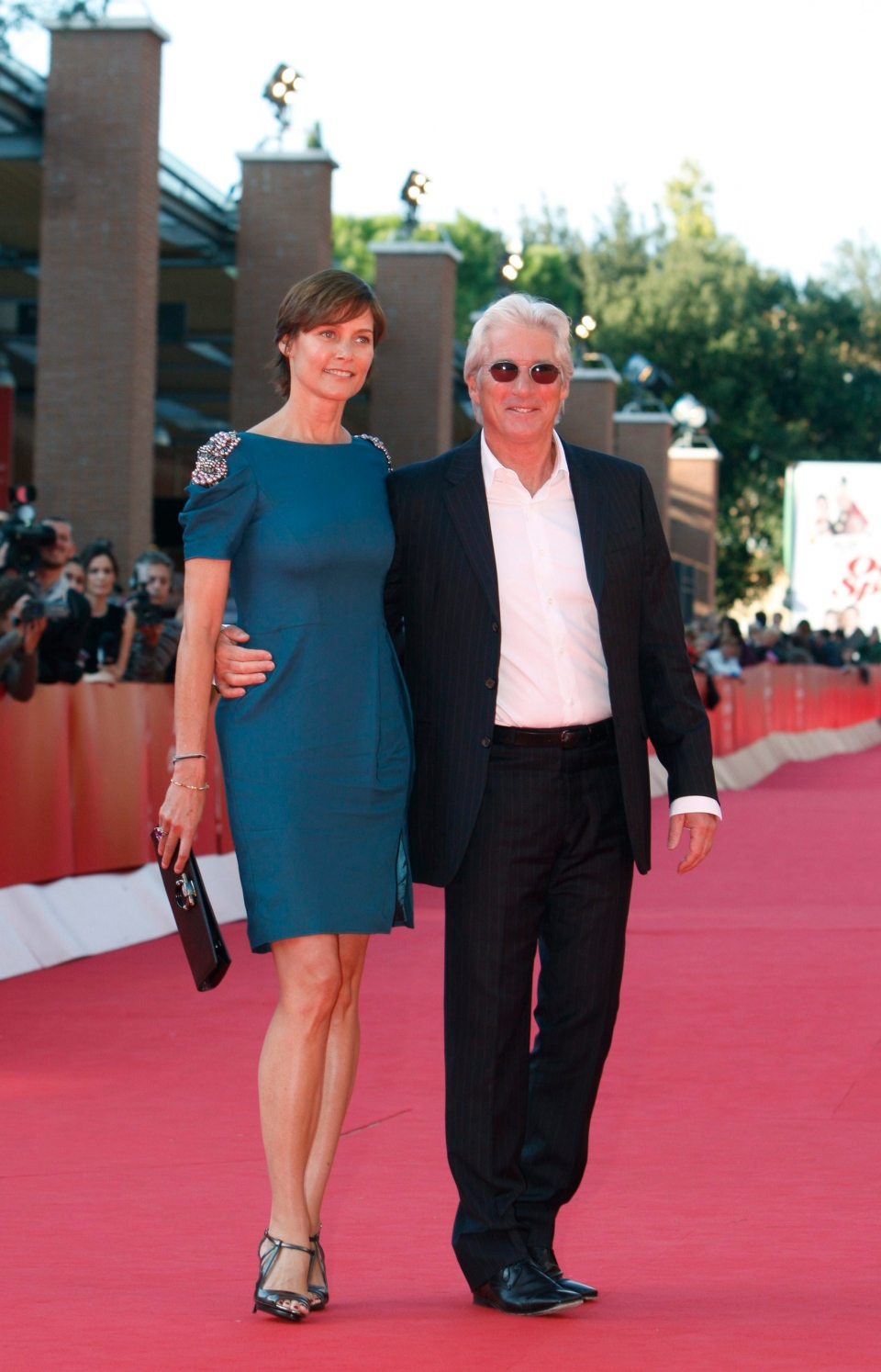 "Actor Richard Gere and his wife Carey Lowell walk the red carpet to present the movie "" Hachiko:A dog's story"" at the Rome Film Festival in Rome, Friday, Oct. 16, 2009.  (AP Photo/Alessandra Tarantino)"