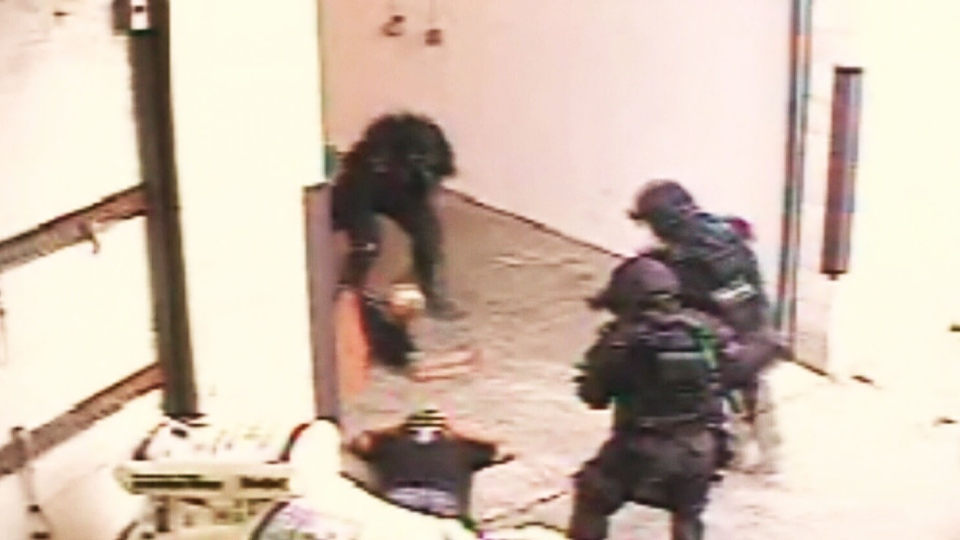 Security camera footage captured the police take down of the Toronto 18 in 2005.