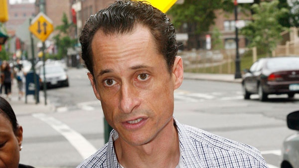 Rep. Anthony Weiner, D-N.Y., is followed by the media as he carries his laundry to a laundromat near his home in the Queens borough of New York, Saturday, June 11, 2011. (AP / David Karp)