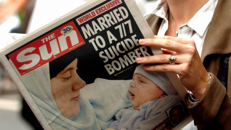 A woman holds a copy of the British tabloid newspaper The Sun, in London, Friday, Sept. 23, 2005 which carries on its front page their story of Samantha Lewthwaite, wife of suspected London suicide bomber Jermaine Linsday. (AP / Andrew Stuart)