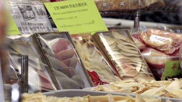 Packages of dried shark fin products are shown in a store in Chinatown in San Francisco, Calif., Thursday, May 5, 2011. (THE ASSOCIATED PRESS / Jeff Chiu)