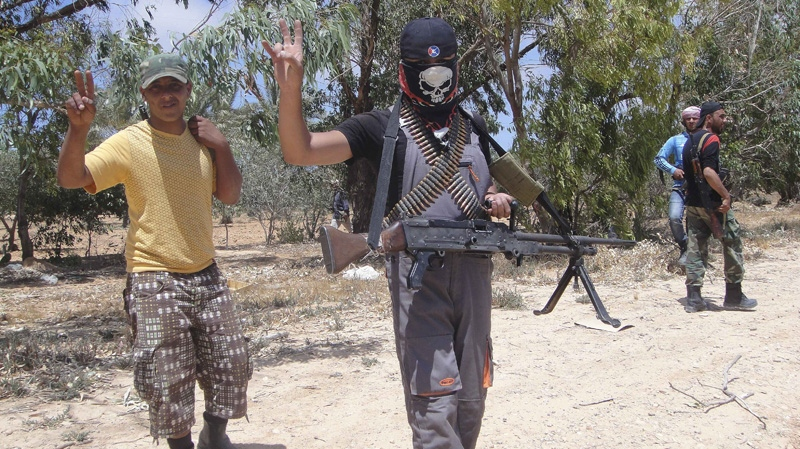 Rebel fighters are seen before a heavy fight against pro-Gadhafi forces at the frontline of Dafneya, some 40 km west Misrata, Libya, Sunday, June 12, 2011. (AP Photo/Hassan Ammar)