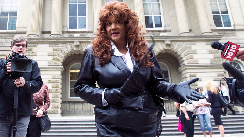Dominatrix Terri-Jean Bedford holds a riding crop as she speaks to media outside the Ontario Appeal Court in Toronto on Monday, June 13, 2011. (Nathan Denette / THE CANADIAN PRESS)