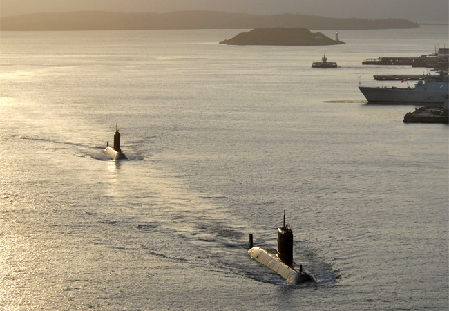 A rare site of two Canadian subs sailing together into homeport. Seen leading the pack is the HMCS Cornerbrook with the HMCS Windsor following. The HMCS Cornerbrook and the HMCS Windsor arrived in the early dawn coming along side in Halifax, N.S. in 2006. (Cpl. Rod Doucet / Canadian Forces Combat Camera)