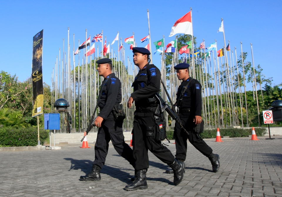 Indonesian police officers patrol around the venue of the Miss World competition in Nusa Dua, Bali, Indonesia, Saturday, Sept. 28, 2013. (AP / Firdia Lisnawati)