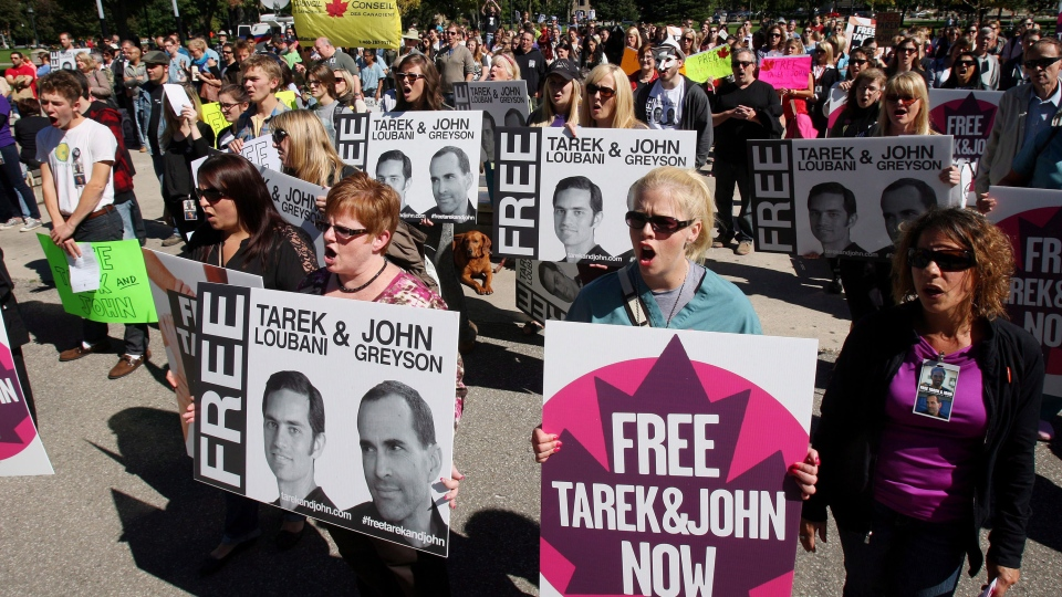 People rally to support a call for the release of two Canadians, Dr. Tarek Loubani and John Greyson detained in Egypt, in London, Ont., Tuesday, Sept. 24, 2013. (Dave Chidley / THE CANADIAN PRESS)