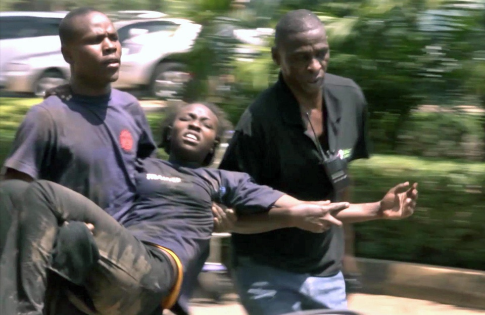 In new video made available Saturday Sept. 28, 2013, showing an injured woman being carried to get first aid after she was caught up in the mall terror attack, in the Westgate Mall in Kenyan capital Nairobi, Saturday Sept. 21, 2013. (AP Photo)