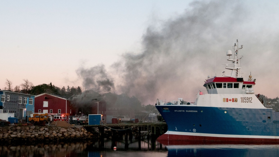 Smoke can be seen from the Dory Shop pier in Lunenburg, N.S. on Saturday, Sept. 28, 2013. (Louise Muenstermann / MyNews.CTVNews.ca)