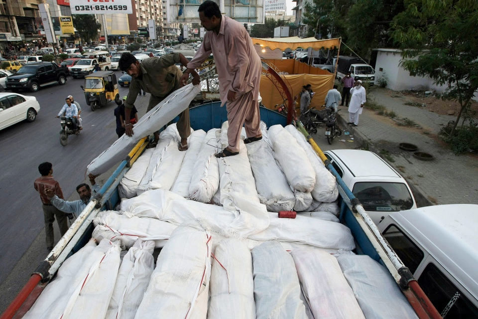 Pakistani volunteers load tents and other relief supplies into a truck to send it for earthquake-affected areas of the Baluchistan province, in Karachi, Pakistan, Saturday, Sept. 28, 2013. (AP / Fareed Khan)