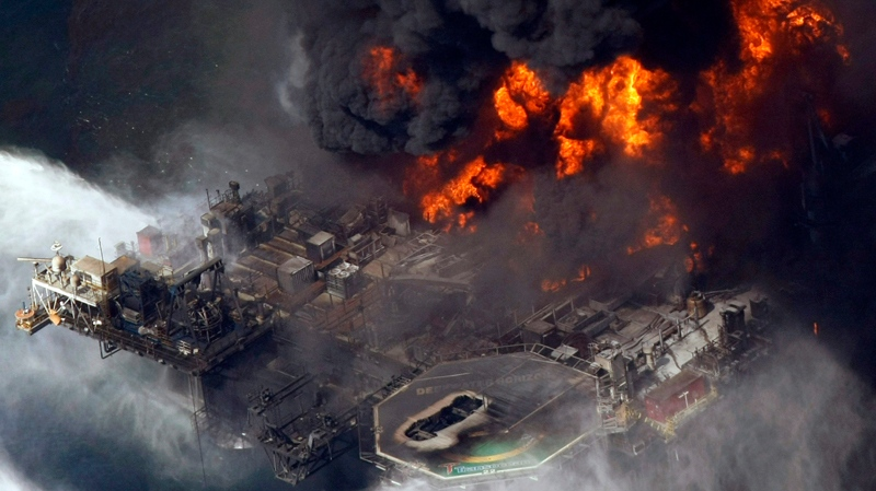 In an April 21, 2010 file photo, the Deepwater Horizon oil rig burns after a deadly explosion in the Gulf of Mexico. (AP / Gerald Herbert, File)