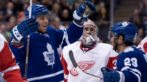 Toronto Maple Leafs' Josh Leivo (left) celebrates his goal with teammate Jerry D'Amigo (29) as Detroit Red Wings goaltender Petr Mrazek looks on during second period NHL pre-season action in Toronto on Saturday September 28, 2013. (THE CANADIAN PRESS / Frank Gunn)
