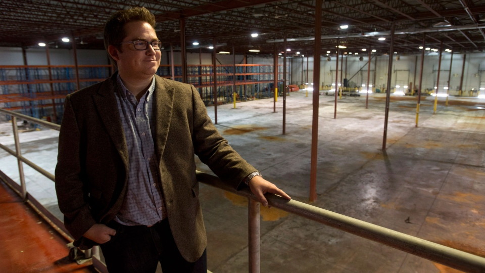Chuck Rifici of Tweed Inc. looks out over the floor of the former Hershey's chocolate factory, Friday September 27, 2013 in Smiths Falls, Ont. (Adrian Wyld / THE CANADIAN PRESS)